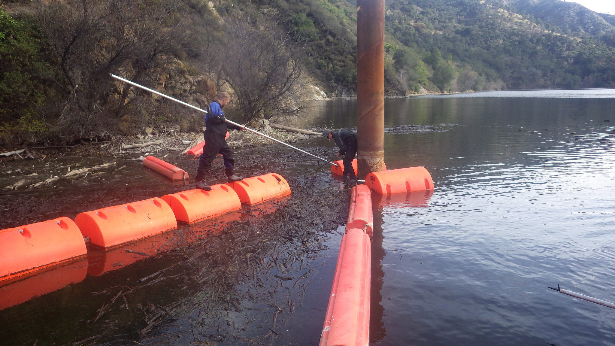 Cleaning debris at Los Padres Reservoir