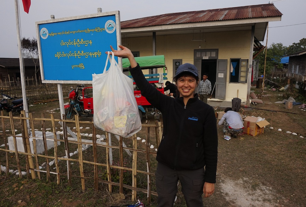FISHBIO biologist collecting trash