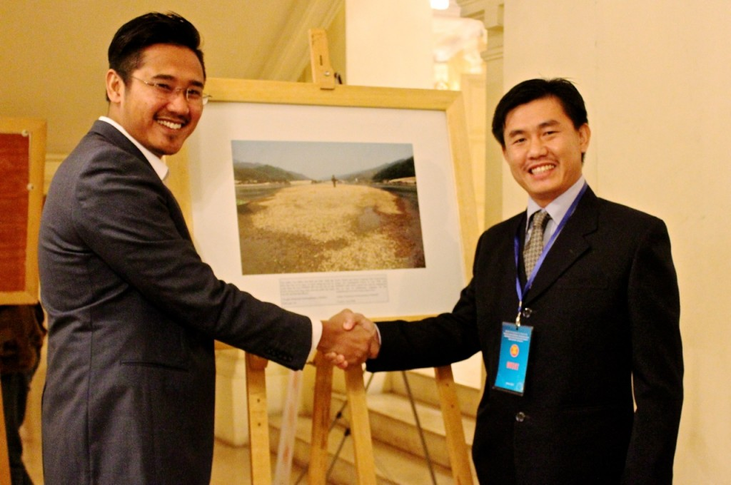 Sinsamout (right) receives congratulations on his photo entry