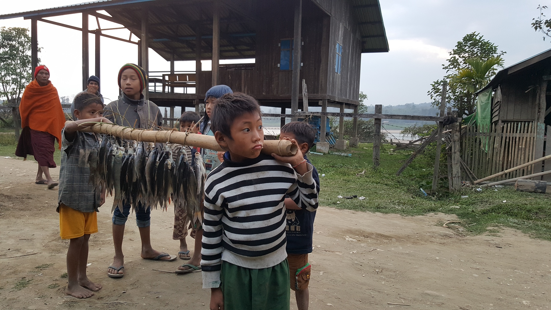 Kids selling fish Chindwin River Myanmar