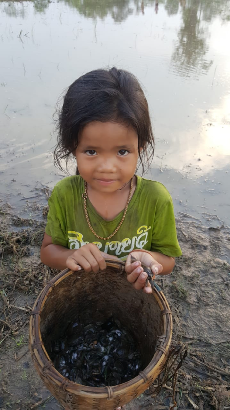 Lao girl with aquatic invertebrates