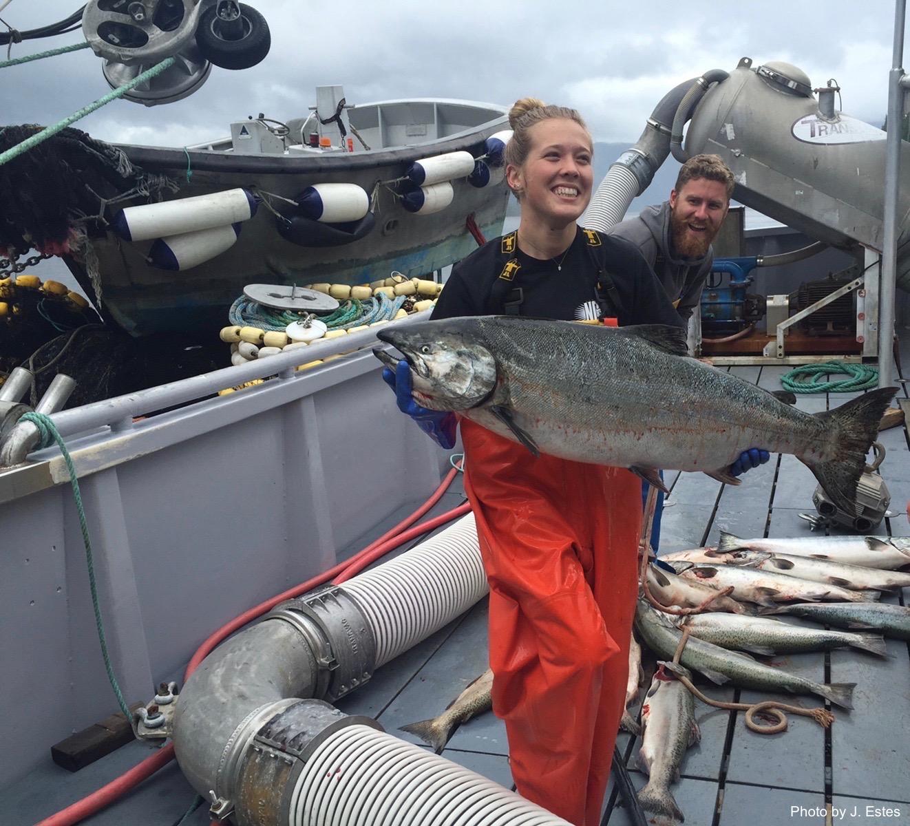 Madisyn Pyorre with Alaskan salmon