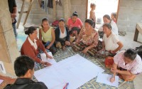 A village women's group discusses the proposed Fish Conservation Zone