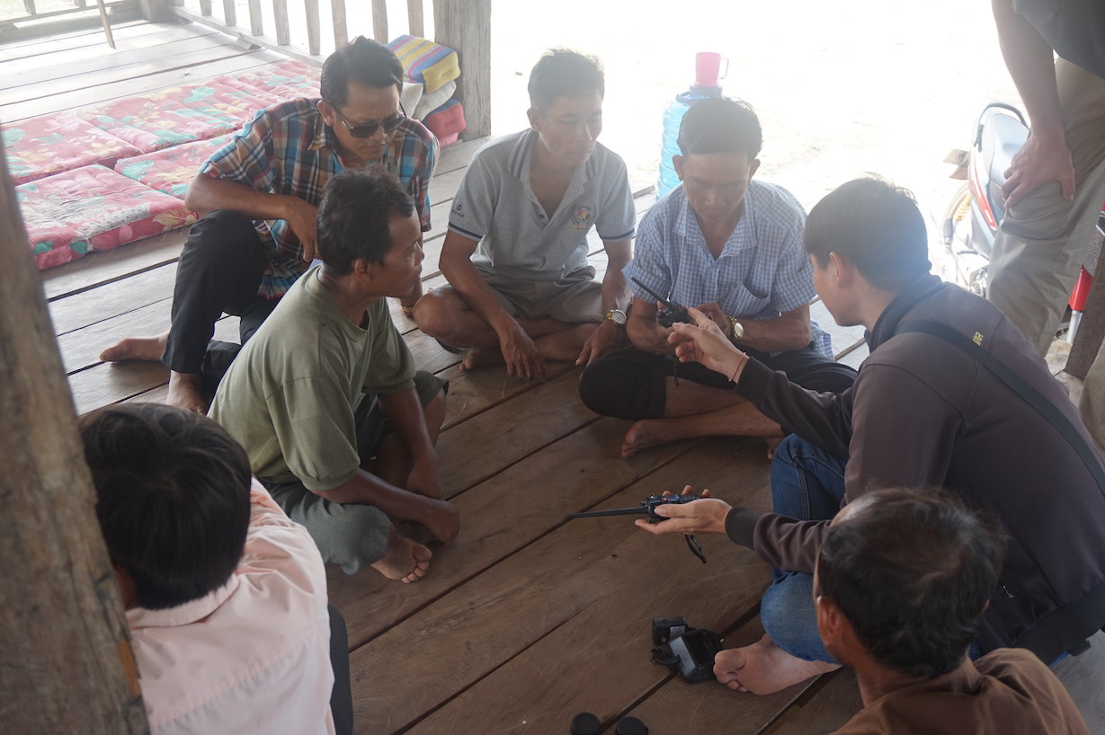 Showing walkie talkies to enforcement team in Kengmeaw