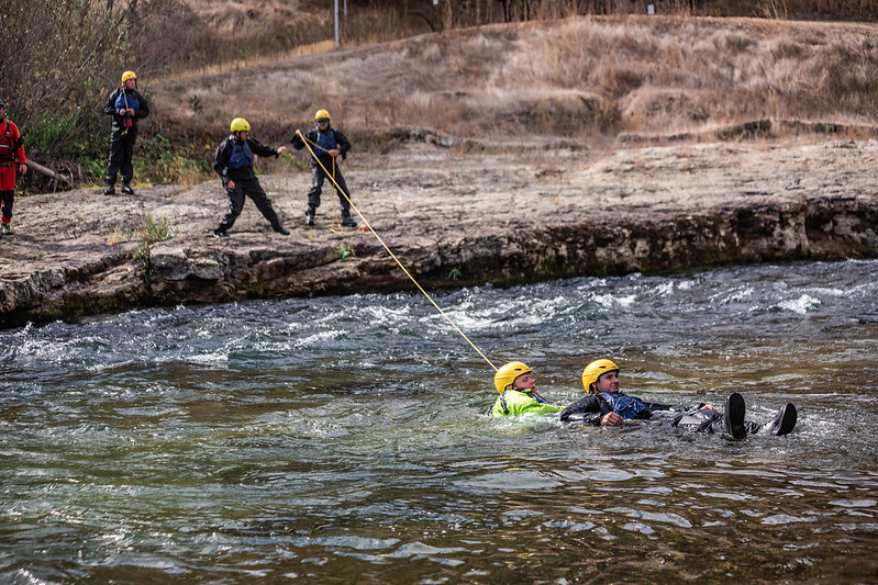Swiftwater rescue training with rope